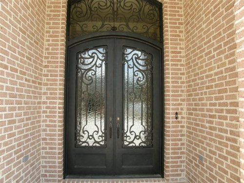 Custom Extra Large Iron Doors with Transom on French Country Exterior