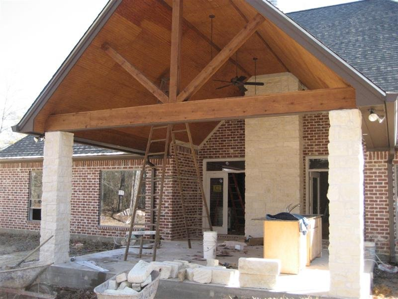 Custom Rustic Cedar Beams and Back Porch with Stone